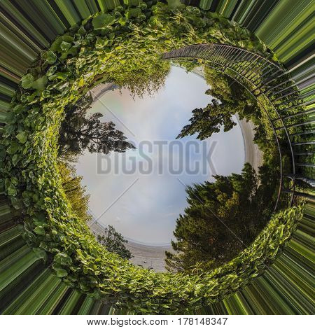 A panoramic landscape turned little planted with trees greenery and bright sky