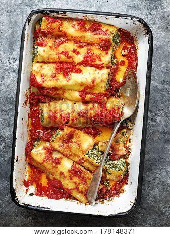 close up of rustic italian spinach ricotta cannelloni pasta