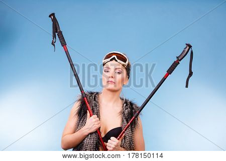 Woman Wearing Bra And Holding Ski Poles