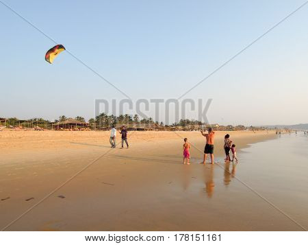 Tourist Making Fly A Kite On The Beach Of Candolim