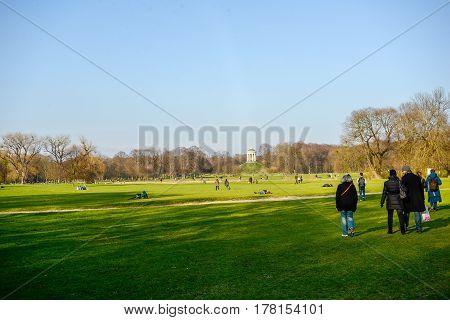 Munich,Germany-March 23,2017:People enjoy the warm early spring weather in the Englischer Garten in Munich