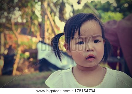 Portrait of liitle girl with angry upset face expression