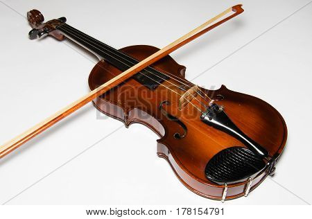 Photo of old violin isolated on white background