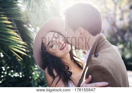 Lovers lifestyle walk in city of Rome Italy brunette in hat