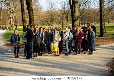 Munich,Germany-March 23,2017: A group tourists takes a guided tour of the Englischer Garten