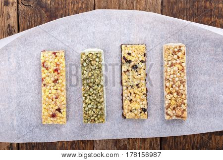 Various muesli / granola bars with nuts cereals dried berries. Healthy energy snack. Top view.