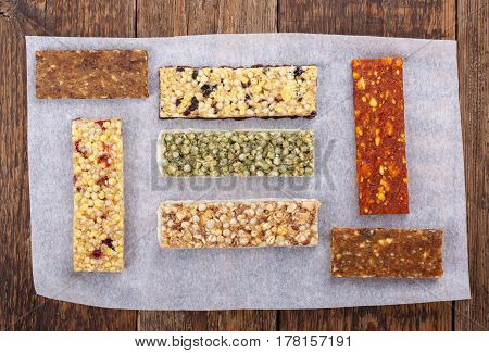 Various muesli / granola / fruit bars with nuts cereals dried berries. Healthy energy snack. Top view.