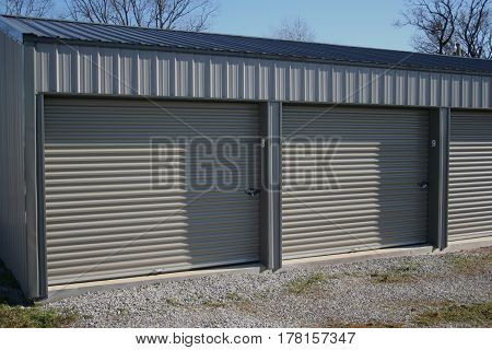 A row of self storage units with over-head doors.