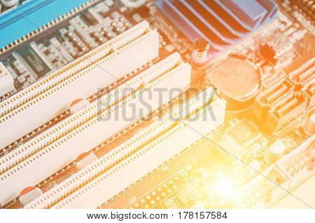 Microcircuit Board Close-up For Electronics And Light Background