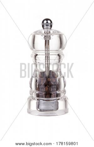 Pepper grinder made of glass isolated on white