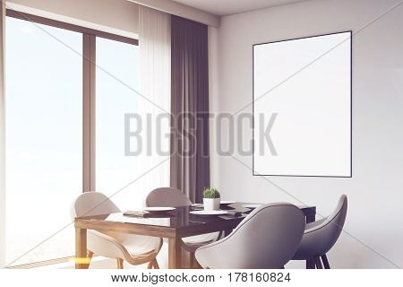 Close up of a dark wood kitchen with a table and a poster. There are countertops and a panoramic window. 3d rendering mock up toned image