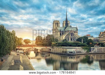 Notre Dame de Paris cathedral reflecting in river on sunrise Paris France