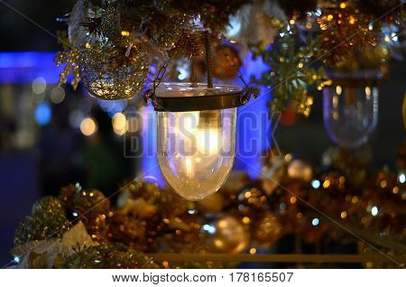 gold light holding christmas with blurred background