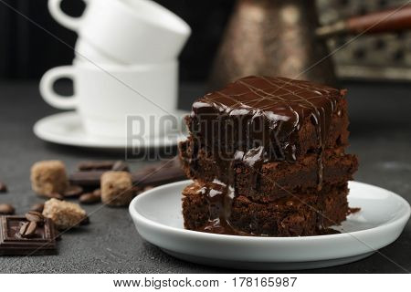 Delicious Homemade Brownie With Chocolate Sauce And Caramel On The Table. Selective Focus