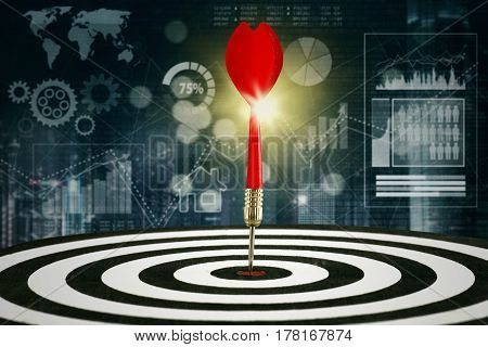 Red dart hitting the bullseye on the dartboard with financial statistics background. Concept of stock market target and financial graph.