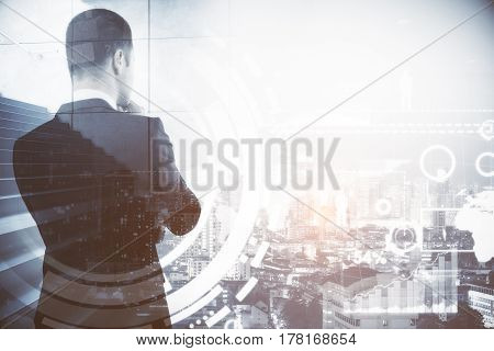 Back view of thoughtful businessperson with stairs on city background. Success and growth concept. Double exposure