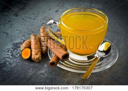 herbal tea with turmeric powderslices and cinnamon