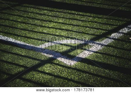 part of the football field with a marking and a shade from the sun.