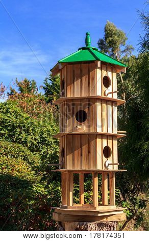 Wooden Birdhouse with multiple holes and levels