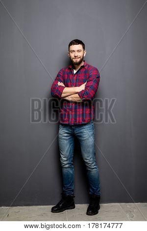 Full Portrait Of Handsome Young Man In Casual Shirt Keeping Arms Crossed And Smiling