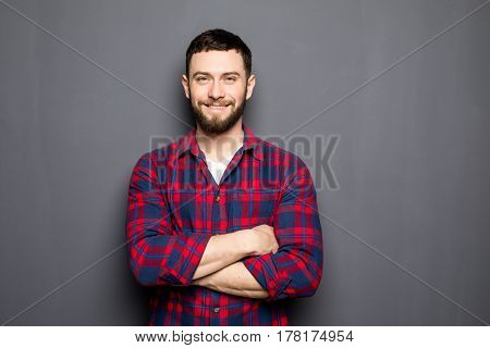 Portrait Of Handsome Young Man In Casual Shirt Keeping Arms Crossed And Smiling