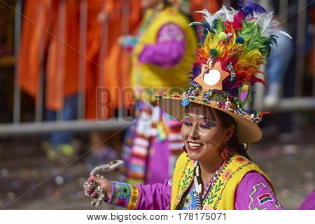 ORURO, BOLIVIA - FEBRUARY 25, 2017: Tinkus dancer in colourful costume performing at the annual Oruro Carnival. The event is designated by UNESCO as being Intangible Cultural Heritage of Humanity.