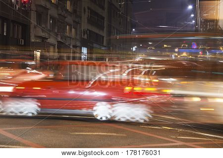 Red car in a high speed by night