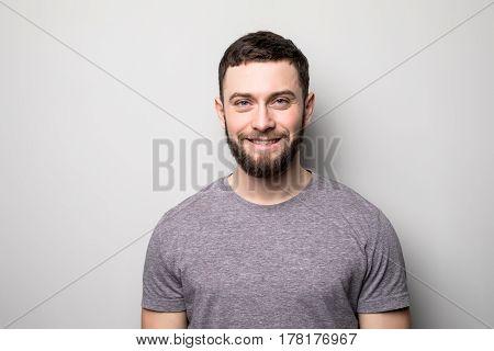 Portrait Of Happy Man On Grey