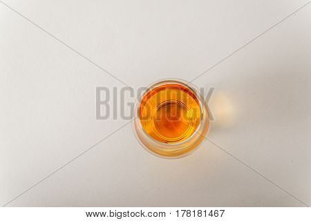 Top View Of A Single Malt Whiskey Glass, On A White Background