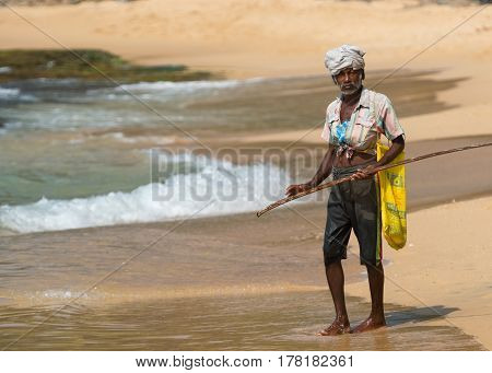 WELIGAMA SRI LANKA - JANUARY 18 2017: Portrait of local fisherman. Tourism and fishing are two main business in this town.