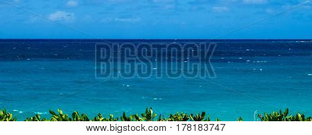 A beautiful panorama view of the ocean during a bright sunny day. New Providence, Nassau, Bahamas.