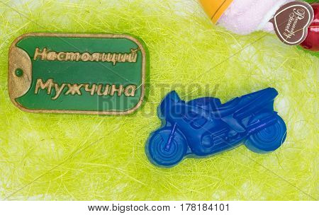 Natural handmade soap is a perfect gift for the holiday especially for men in the form of motosycle and a badge contains an inscription in Russian