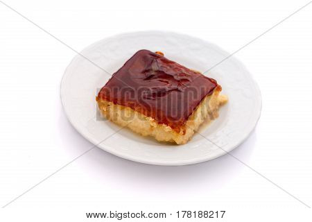 Spanish tres leches dessert on white background front view