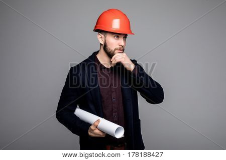 Happy Young Businessman Architect On Grey Background