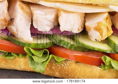Real close up on submarine chicken sandwich.