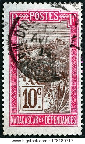 MALAGASY - CIRCA 1903: a stamp printed in Malagasy Madagascar shows Transportation by Sedan Chair circa 1903