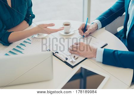 Close Up Photo Of Man's Hands Signing An Agreemant. Broker Giving Some Advice About New Purchase
