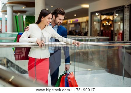 It's Time For Shopping And Fun. Cute Cheerful  Successful Happy Lovely Couple In Jacket Holding Colo