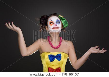 portrait of happy clown on a dark background