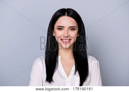 Portrait Of Beautiful Charming Young  Woman With Black Hair  Smiling On Gray Background