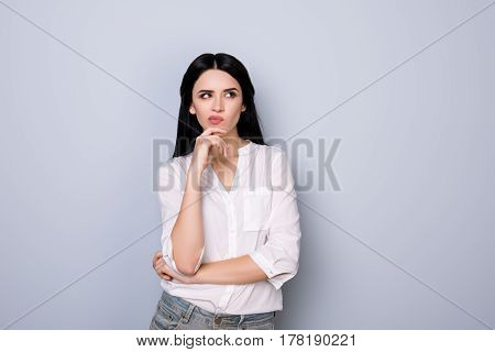 Portrait Of Beautiful Cute Young  Woman With Pouted Sensual Lips And Black Hair Fink About New Idea