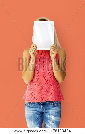 Woman holding tablet cover her face