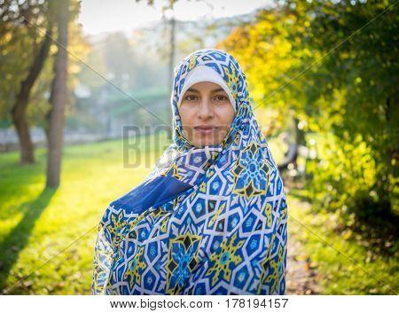Muslim Arabic young beautiful woman in nature