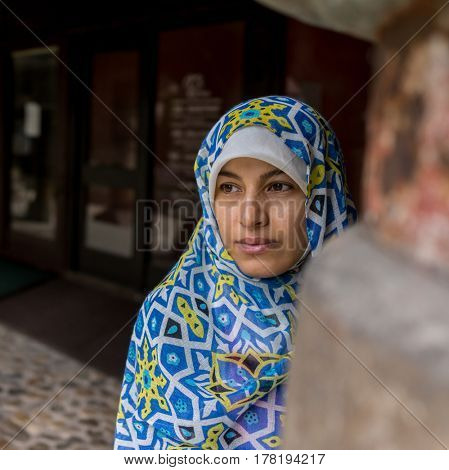 Muslim traditional woman visiting old historical city