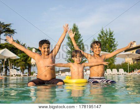 Children enjoying in tropical resort on the pool