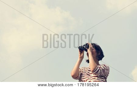 Woman using binocular explore searching