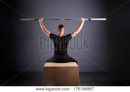 Crossfit fitness gym heavy weight lifting bar by strong man workout