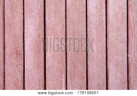 Texture of old wooden slats, brown, as background.