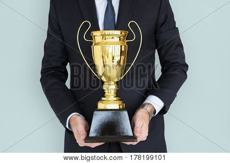 Business Man Holding Trophy Award