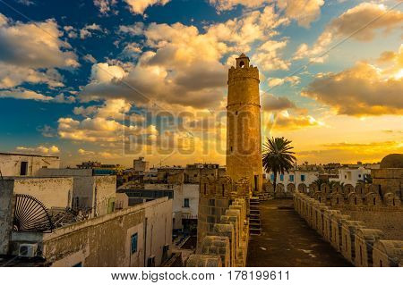 View from the walls of the fortress of Ribat of Sousse in Tunisia. Medieval architecture in sunset light.